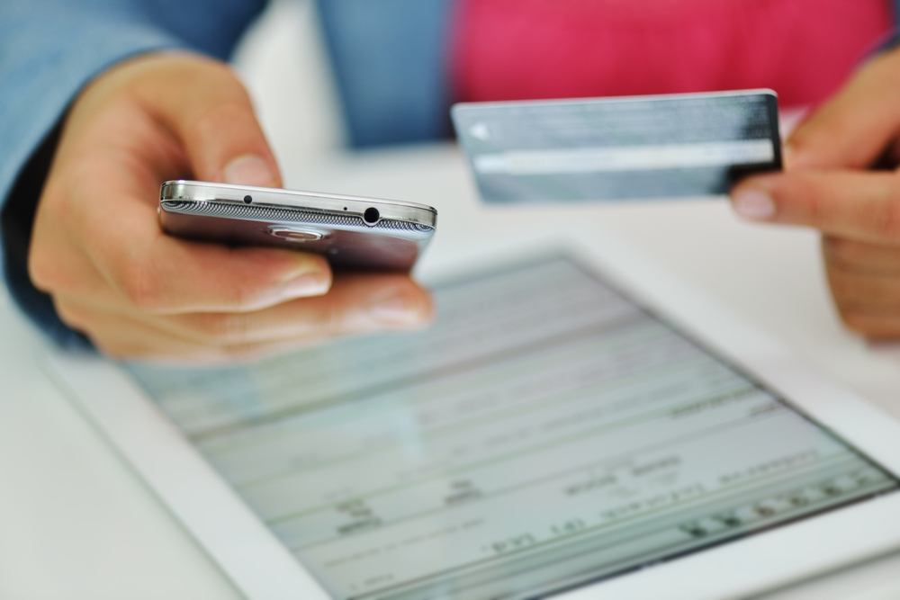 Human hand on tablet pc and credit card for shopping online